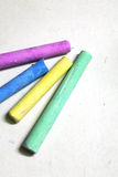 Colored chalks. On the white background Royalty Free Stock Photos