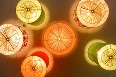 Colored chandeliers on ceiling in nursery. Royalty Free Stock Images