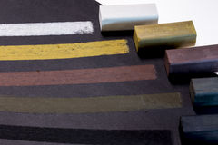 Colored charcoal sticks for drawing. On black paper on white backround Vector Illustration