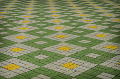 Colored checkered tile on the street Royalty Free Stock Photography