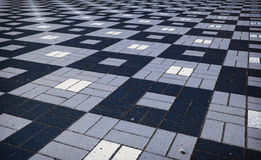 Colored checkered tile on the street Royalty Free Stock Photos