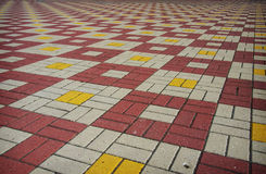 Colored checkered tile on the street Stock Photo