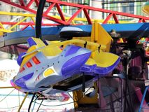 Colored children`s carousel wheel in winter Park. Object stock images