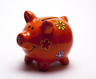 Colored children`s piggy Bank on white background. /pig piggy Bank for kids/  objects, ceramics, children Stock Image