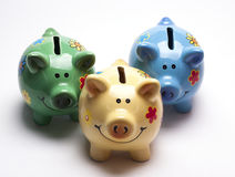Colored children`s piggy Bank on white background royalty free stock photos
