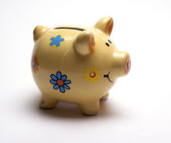 Colored children`s piggy Bank on white background. /pig piggy Bank for kids/  objects, ceramics, children Royalty Free Stock Photography