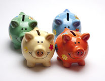 Colored children`s piggy Bank on white background. /pig piggy Bank for kids/  objects, ceramics, children Royalty Free Stock Photos