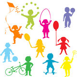 Colored children silhouettes playing Stock Photography