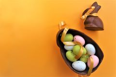 Colored chocolate Easter eggs and chocolate bunny stock photography
