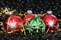 Colored Christmas balls on black velvet Stock Image