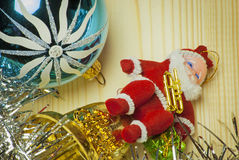Colored Christmas balls and tinsel on a wooden background Royalty Free Stock Images