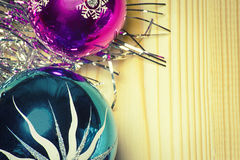 Colored Christmas balls and tinsel on a wooden background Stock Photo