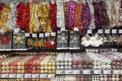 Colored christmas decorations for seasonal sales in big supermarket Stock Photography