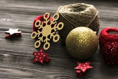 Colored christmas decorations, skein of threads, wooden figure Royalty Free Stock Photos