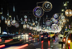 Colored Christmas lights and ornaments, stars and globes. In downtown of  Bucharest, Romania night time Royalty Free Stock Photos
