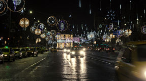 Colored Christmas lights and ornaments, stars and globes. In downtown of  Bucharest, Romania night time Stock Image
