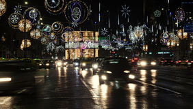 Colored Christmas lights and ornaments, stars and globes. In downtown of  Bucharest, Romania night time Stock Photo