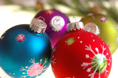 Colored christmas ornaments. Brightly colored christmas ornaments painted with snowflakes Royalty Free Stock Photos