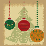 Colored christmas. Some colored circles with a green tree in the background Royalty Free Stock Image