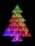 Colored christmas tree 2. Abstract christmas tree in rainbow colors on a black background Royalty Free Stock Photo