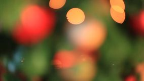 Colored Christmas Tree lights background. Intermittent abstract lights background, orange lights composition stock video