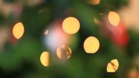 Colored Christmas Tree lights background. Intermittent abstract lights background, orange lights composition stock video footage