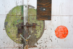 Colored circles. And locked door of an old abandoned industrial warehouse Royalty Free Stock Photos