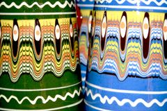 Colored clay cups detail Royalty Free Stock Images