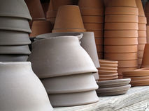 Colored Clay Pots and Saucers. Royalty Free Stock Photo