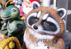 Colored clay raccoon and dino Royalty Free Stock Images