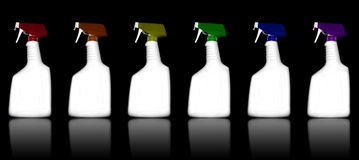 Colored Cleaning Bottles. A rainbow of white cleaning bottles are lined up on a black reflective surface royalty free illustration