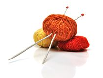 Colored clews and knitting needles. Isolated on white Royalty Free Stock Images