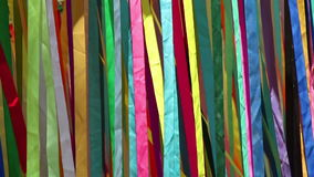 Colored cloth bands on wind stock footage