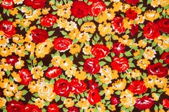 Colored cloth with bright flowers, background Stock Images