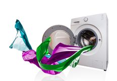 Colored cloth flying from washing machine Stock Photo