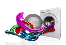 Colored cloth flying from washing machine Royalty Free Stock Photos