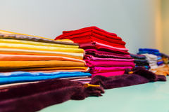 Colored cloth folded on the shelf. Yellow, blue and red cloth folded on the shelf Royalty Free Stock Image
