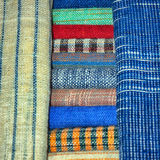 Colored cloth,linen textiles. Laos. Luang Prabang -  Laos, textiles for sale, colored cloth,linen textiles Royalty Free Stock Photography