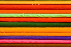 Colored cloth. Rolls of colored cloth stacked up in a tailors in Rajathan, India Stock Images
