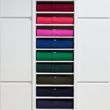 Colored clothes folded on the shelf Royalty Free Stock Photo