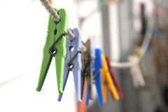 Colored clothes-pins Royalty Free Stock Images