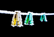 Colored clothespins. On a rope in winter Stock Photo