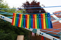 Colored clothespins Stock Photo