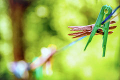 Colored clothespins. Hanging on the rope Royalty Free Stock Images