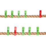 Colored clothespins on a rope. Isolated over whine background Royalty Free Stock Photos