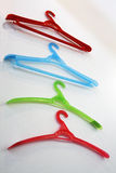 Colored coat hangers. Stock Images