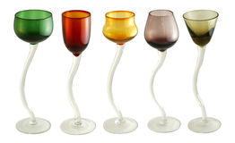 Colored cocktail glasses. Fun colorful handcrafted coktail glasses with curved handle isolated on white Stock Image