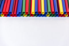 Colored cocktail straws. On white background Royalty Free Stock Images