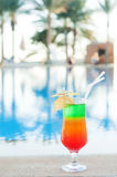 Colored cocktails on a background of water. Stock Photos