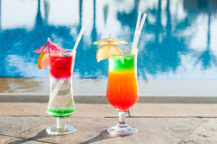 Colored cocktails on a background of water Royalty Free Stock Images